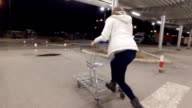 Woman haveing fun with shopping cart
