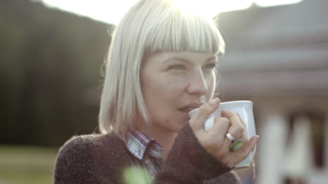 Woman having a cup of tea outdoors