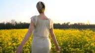 HD SLOW-MOTION: Woman Having Fun Running In The Field