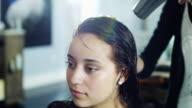 CU Woman having hair dried in hair salon / Lehi, Utah, USA