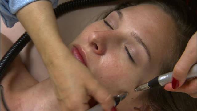 ZO, CU, HA, Woman having micro-current wrinkle reducing treatment