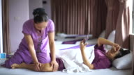 Woman having relaxing with Thai massage