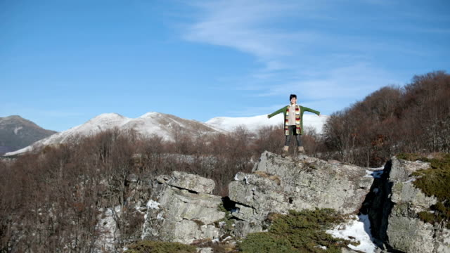 Woman high on mountain