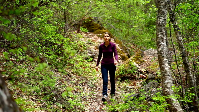 Woman hiking on trail