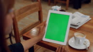 Woman hold Green screen Digital tablet