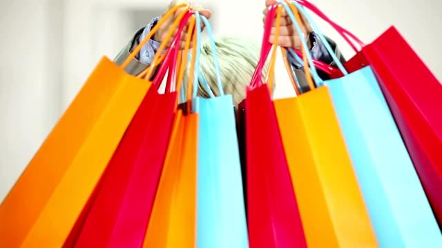 Woman holding a few shopping bag