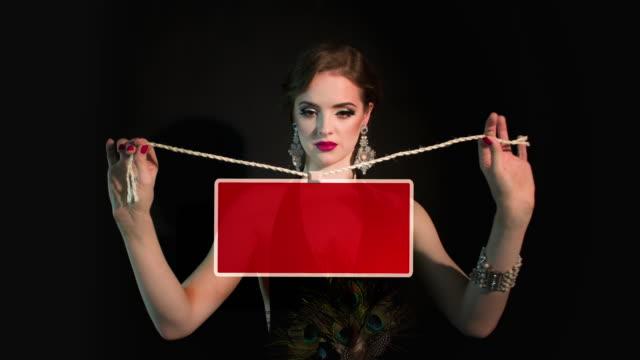Woman holding a red blackboard