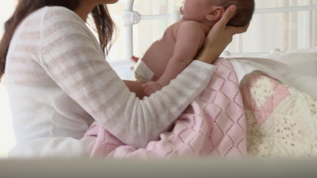 MS TU Woman holding newborn baby girl on blanket / Richmond, Virginia, USA