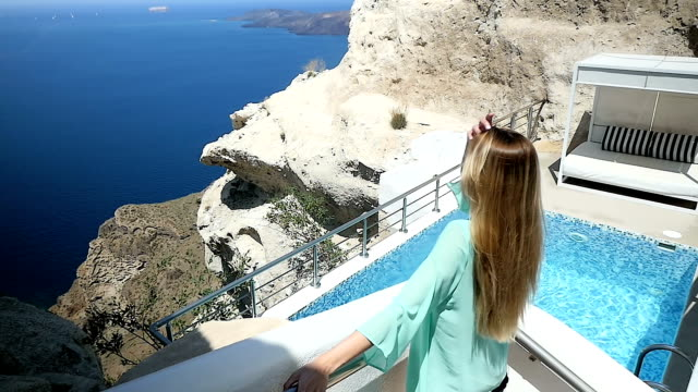 Woman & holiday villa & Santorini