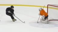 Woman ice hockey goalie saving net