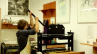 woman in a printing shop