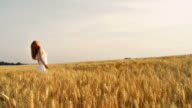 HD: Woman In A Wheat Field