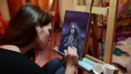 Woman in Alex grey Painting Workshop