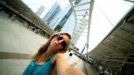 Woman in Bangkok taking selfie