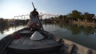 MS Woman in conical hat rowing on Thu Bon river / Hoi An, Quang Nam, Viet Nam