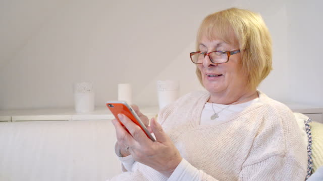 woman in her 70s with smart phone