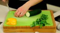 woman in kitchen chopping vegetables- hd video