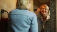Woman in mirror happy
