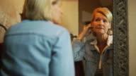 Woman in mirror unhappy