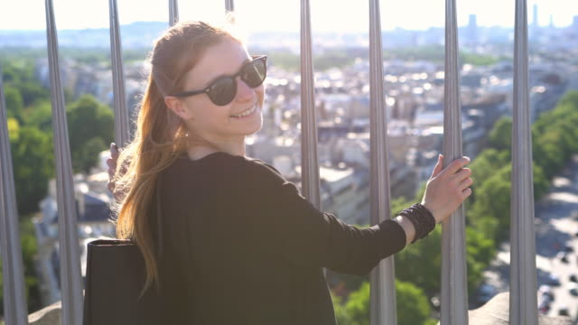 Woman in Paris enjoying the view from top of Triumphal Arch