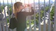 Woman in Paris photographing the city from above