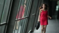 SLO MO Woman in red dress running along corridor.