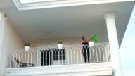 HD: Woman in the balcony