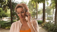 Woman in town talking on mobile phone.