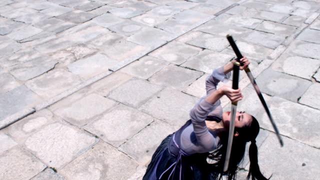 MS Woman in traditional dress performing sword dance / Seoul, South Korea
