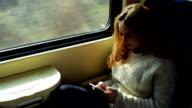 Woman in train using phone