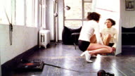 OVEREXPOSED woman in underwear squatting in front of mirror in apartment + turning to camera
