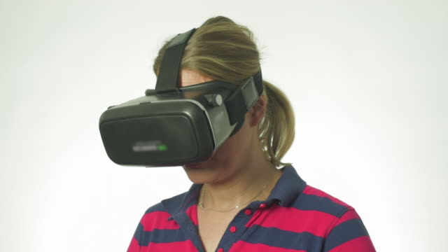 Woman in VR Mask looks up and smiles