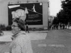 A woman in West Berlin waves to someone in East Berlin 1963
