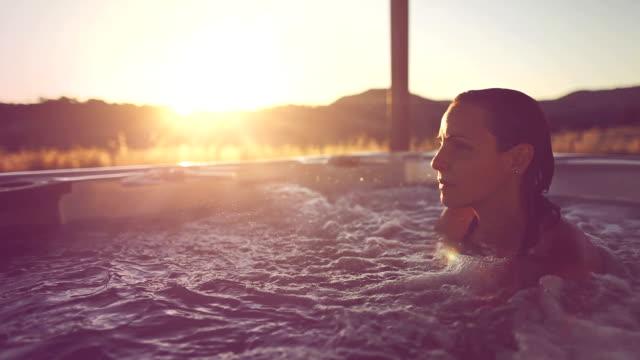 Woman in whirlpool jacuzzi