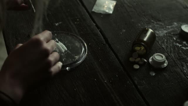 Woman inhaling cocaine