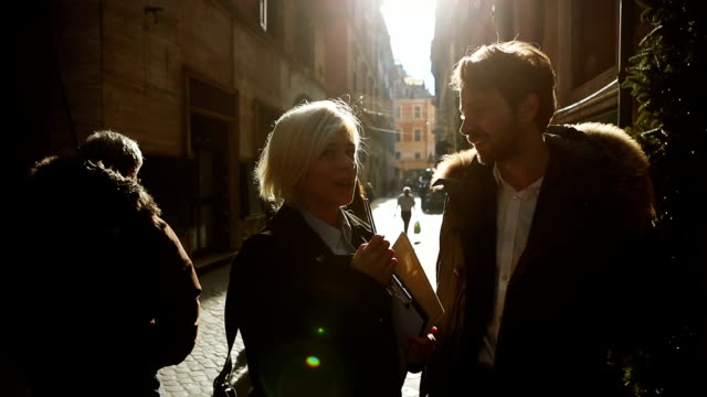Woman interview business man in Rome
