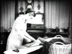 1923 MS Woman ironing shirt / United States