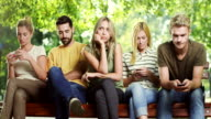 Woman is getting bored while all his friends looking at phone