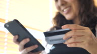 Woman is shopping online using a smartphone, Slow motion