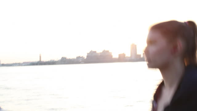 MS POV Woman jogging along Hudson river / New York City, New York, United States