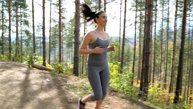 Woman jogging in the forest.