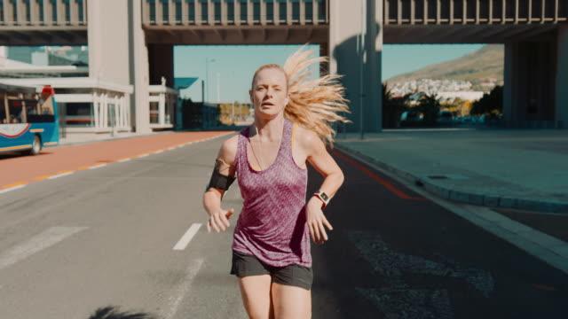 Woman jogging in urban setting