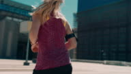 Woman jogging in urban setting
