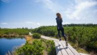 Woman jogging, rear view