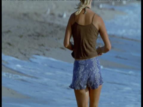 Woman jogs on Miami Beach