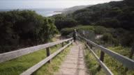 A woman jumping and enjoying the views, at Mornington Peninsula, Victoria, Australia