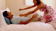 Woman jumping on her partner