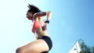 HD SUPER SLOW-MO: Woman Jumping Over Hurdles