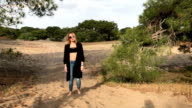 Woman kicking sand slow motion