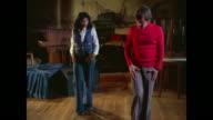 1976 - Woman learns to striptease dance